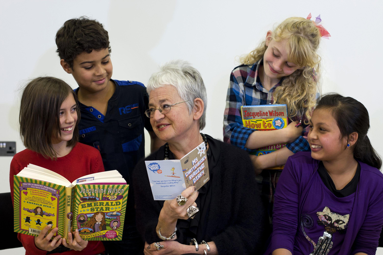 Author Jacqueline Wilson reading to children